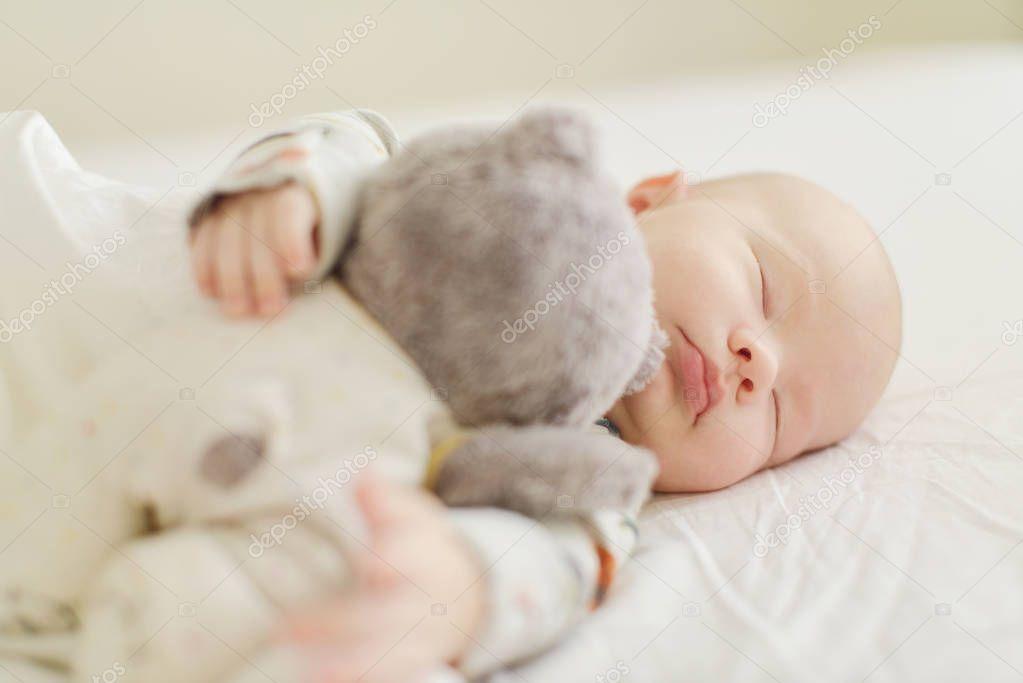 sites/74247825/depositphotos_216476136-stock-photo-newborn-sleeping-bear-bed.jpeg