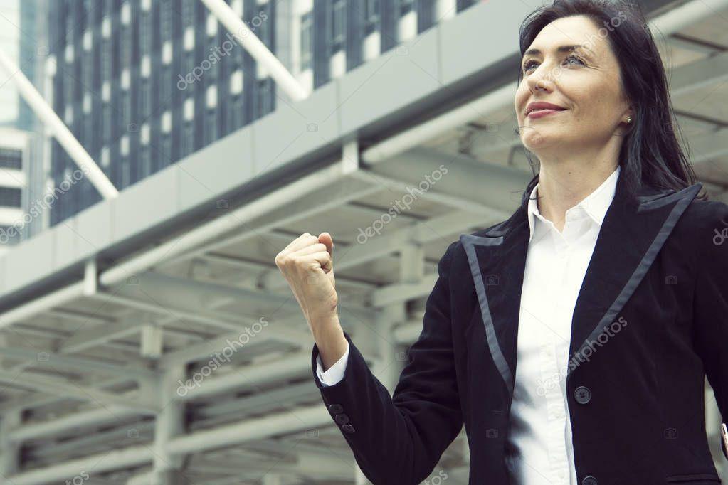 sites/88652954/depositphotos_232740626-stock-photo-businesswoman-raised-her-hand-happy.jpeg
